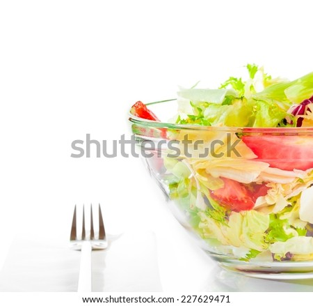 detail of italian fresh salad with fork on white background diet concept