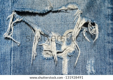 Detail of jeans with tears - stock photo