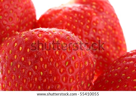Detail of juicy ripe strawberries isolated on white - stock photo