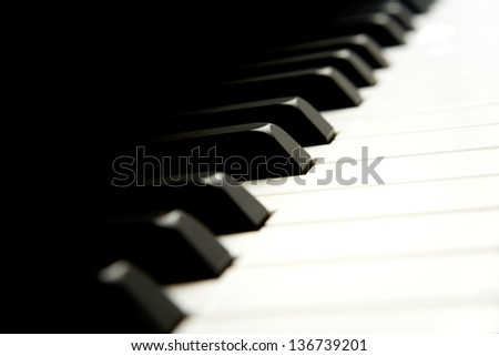 detail of keys on a piano ready for music concert - stock photo