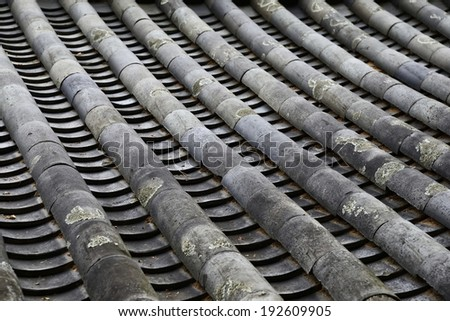detail of Korean traditional tiled roof - stock photo