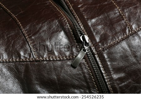 Detail of leather coat with scarf and the zipper  - stock photo