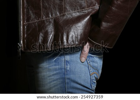 Detail of leather jacket and jean - stock photo