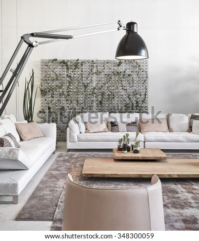 detail of leather sofa and armchair in the modern living room - stock photo