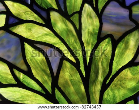 Detail of leaves in stained glass window - stock photo