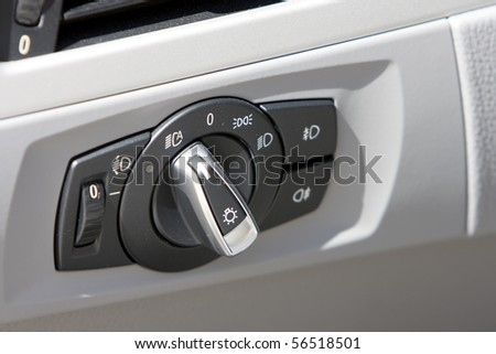 Detail of lights button control on a business car interior (Photographed with shallow DOF, selective focus) - stock photo