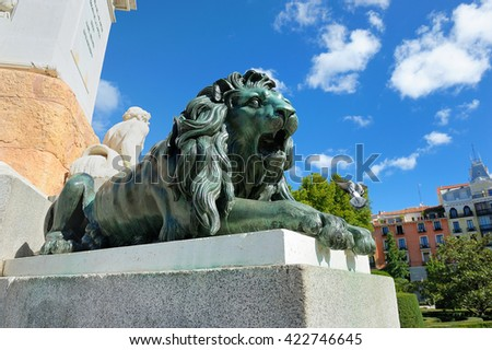 Detail of lion sculpture in front of royal palace in madrid - stock photo