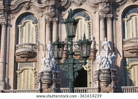 Detail of Lorca Theater building facade with statue in Havana, Cuba