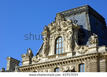 Detail of Louvre palace with nice sculptures - stock photo