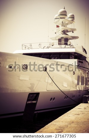 Detail of luxury ship, docked at port. Vintage tones. - stock photo