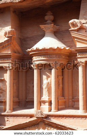 Detail of 3.5 m high urn in the middle of second level of Treasury (Al-Khazneh)  in ancient city of Petra in Jordan. It was carved out of a single rock. It is now an UNESCO World Heritage Site. - stock photo