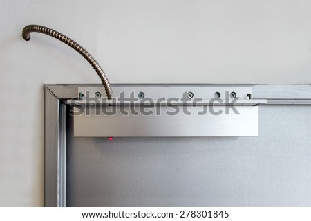 detail of magnetic sensor armored for door - stock photo