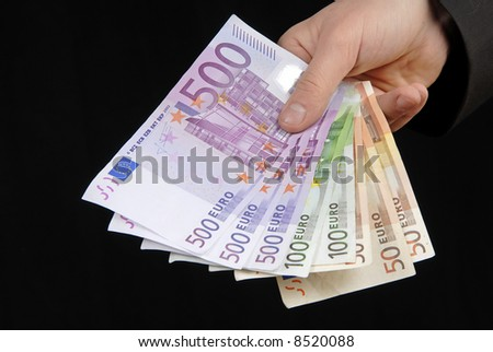 detail of man hand with lots of money - stock photo