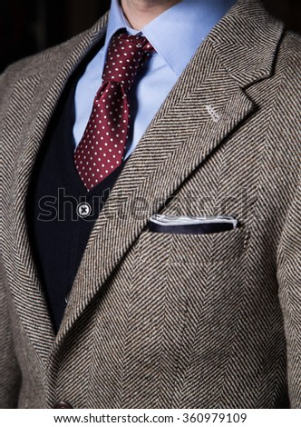Detail of man in suit pocketsquare and tie - stock photo