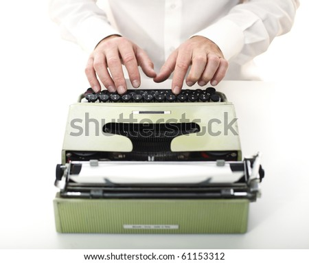 detail of man with typewriter selective focus image - stock photo
