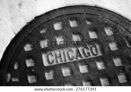 Detail of manhole cover on Chicago street texture - stock photo