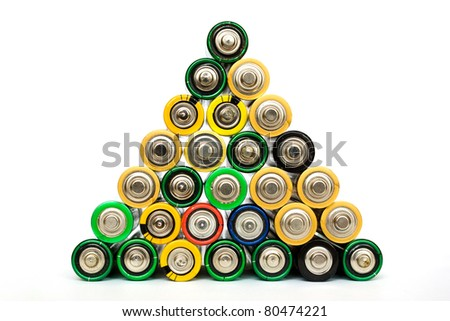 Detail of many assorted AA batteries stacked in a pyramid isolated on a white background - stock photo
