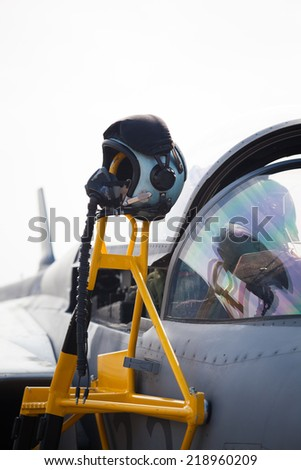 Detail of military fighter/interceptor/jetplane cockpit with pilot's oxygen mask and helmet, ready to take off in case of terrorist attack (colorful image) - stock photo