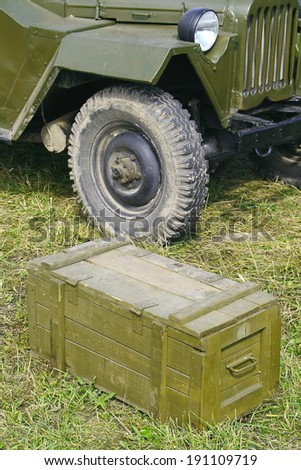 Detail of military vehicle and a wooden box closeup  - stock photo