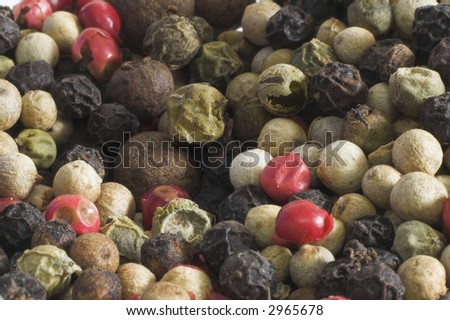 Detail of mixed pepper grains - stock photo