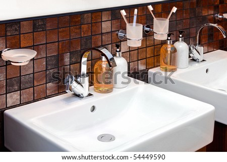 Detail of modern bathroom with white ceramic sink - stock photo