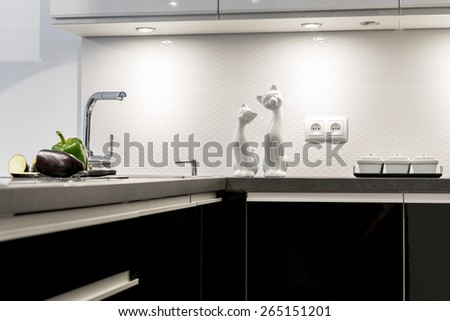 Detail of modern black and white kitchen clean interior design - stock photo
