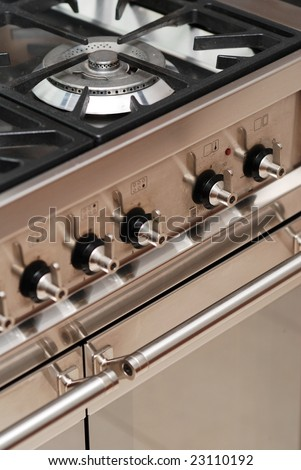 Detail of modern cooker with oven - stock photo