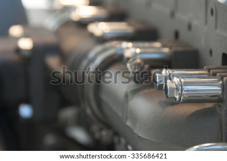 Detail of modern  engine exhaust pipe of the tractor - stock photo