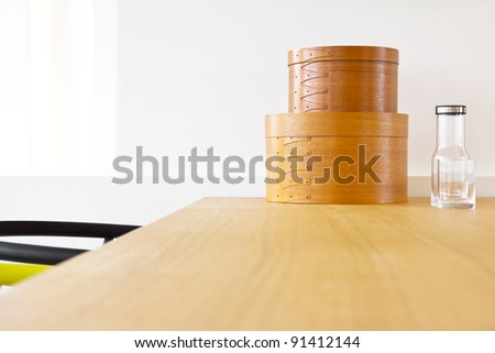 detail of modern interior decoration ,wooden box ,bottle,glass
