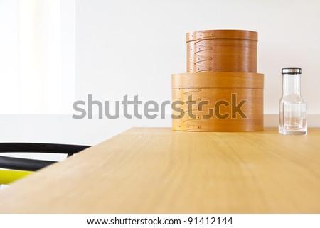 detail of modern interior decoration ,wooden box ,bottle,glass - stock photo