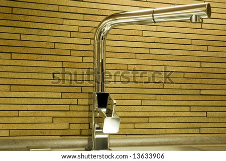 Detail of modern kitchen sink. - stock photo