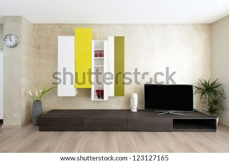 detail of modern living-room - wall with TV - stock photo