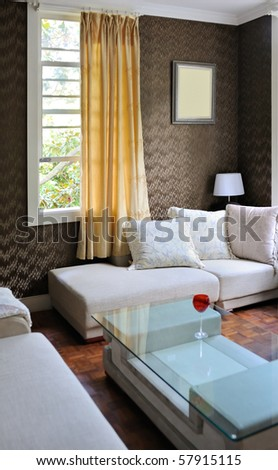 Detail of modern living room with table and sofa - stock photo