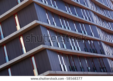 Detail of modern office building with tall and narrow windows - stock photo