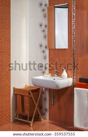 detail of modern private bathroom interior in orange with floral motif