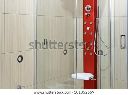 Detail of modern shower interior with glass door