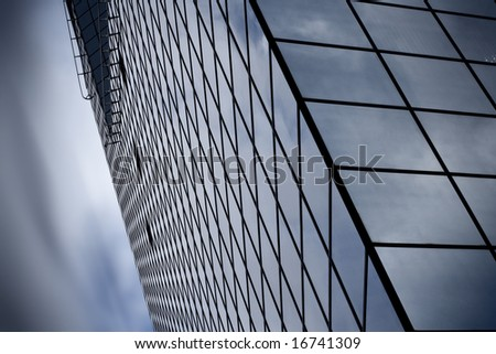 Detail of modern skyscraper. Psychedelic sky. - stock photo