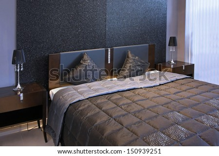 Detail of modern sparkling bedroom interior bed - stock photo