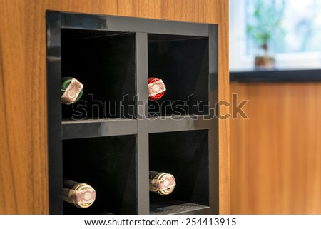 Detail of modern vine storage place in fancy interior design - stock photo
