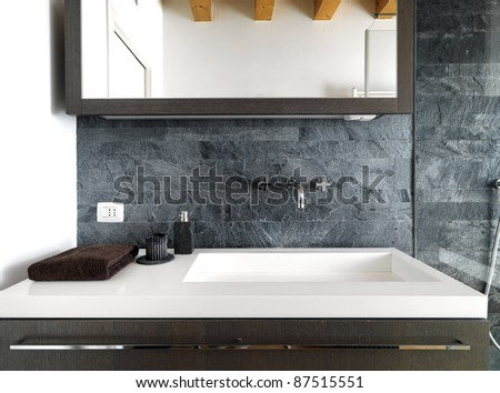 detail of modern washbasin in modern bathroom - stock photo