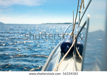 Detail of motor boat cruising in the sea - stock photo