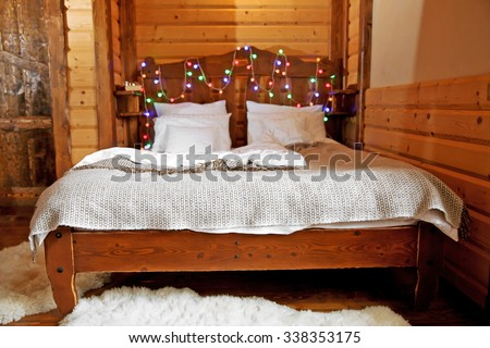 Detail of mountain wooden lodge bedroom - stock photo