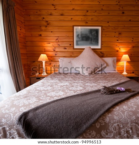 Detail of mountain wooden lodge bedroom. Fox Glacier Lodge, Fox Glacier, West Coast, South Island, New Zealand. - stock photo