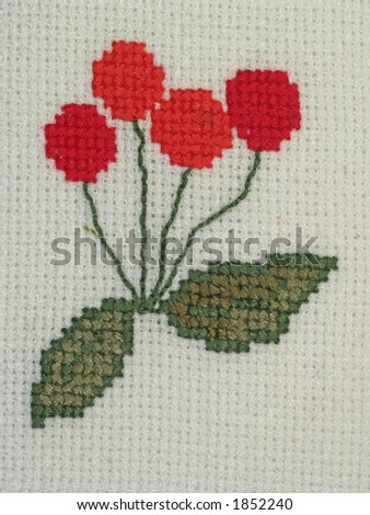 Detail of napkin embroidery (cherry), close-up - stock photo