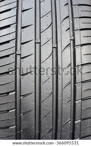Detail of new car tire track. - stock photo