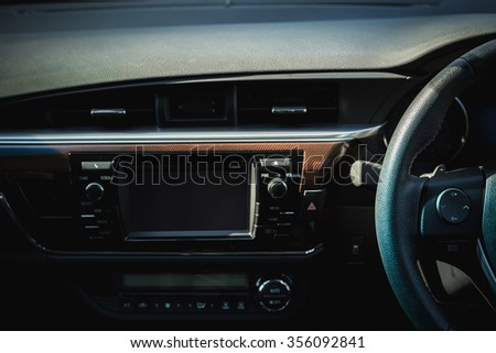 Detail of new modern car interior, Focus on steering - stock photo
