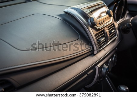 Detail of new modern car interior, Focus on stereo screen - stock photo