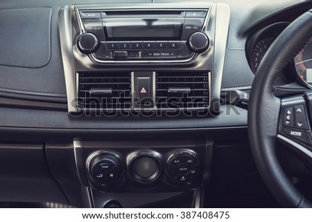 Detail of new modern car interior, Focus on stereo screen (vintage filter effect) - stock photo