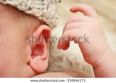 Detail of newborn baby ear - stock photo