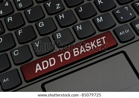 Detail of Notebook Keyboard  With Add to Basket Sign - stock photo